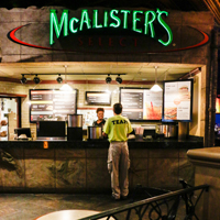McAlister's Deli History. McAlister's Deli was founded in in Oxford, Mississippi by Dr. Don Newcomb, a retired dentist. The original restaurant was opened in a renovated gas station and some of those original design elements are still incorporated into the design of the restaurants, such as garage door and black and white tile.