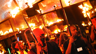 Flambeaux Marchers At New Orleans Mardi Gras Parades