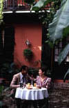 Couple Dining in Courtyard