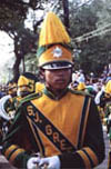 A High School Band Member Marches in a Mardi Gras Parade