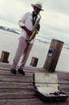 Sax Player On the Mississippi River